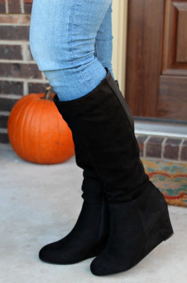 An outfit perfect for your fall fashion needs. The tall wedge boot is very versatile, allowing you to dress it up or down. It looks just as great with a dress for going out or an event, as it does with jeans and a cute shirt.