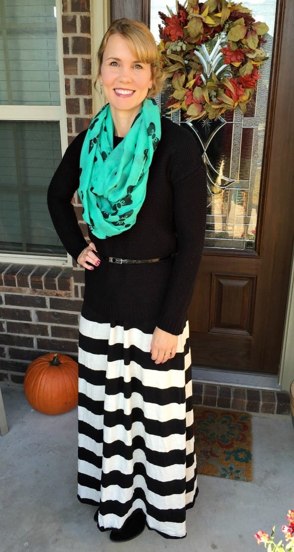This fall maxi dress outfit is the perfect way to transition your favorite maxi dress to a cooler season. Add a sweater, belt and scarf and you're ready to take on those cooler temps.