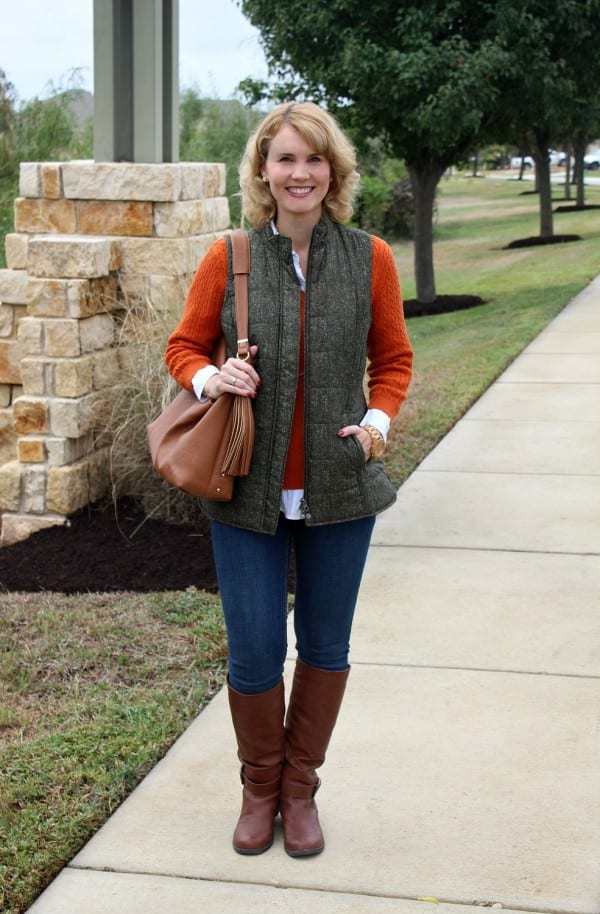 Dressing for fall and winter is all about layering. This fall outfit idea not only features the colors of season, but also features layers I love. Pair a crisp white button up with a cable knit sweater, quilted vest, your favorite skinny jeans and riding boots.