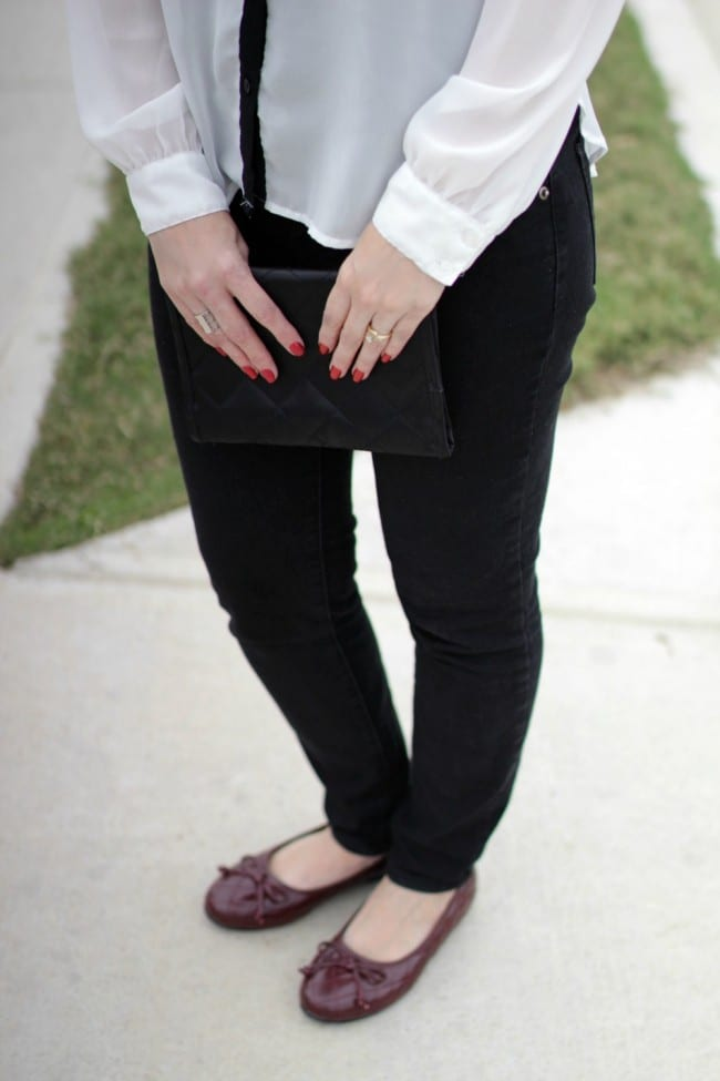 Black and white outfit idea - I styled a pair of black jeans with a white and black long sleeve shirt, burgundy bow flats and a statement necklace.