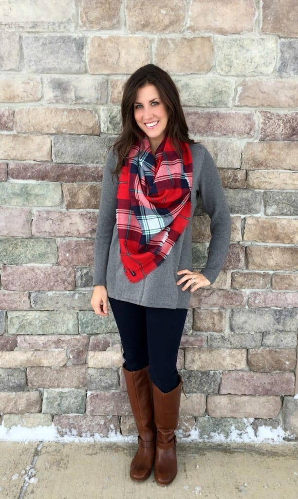 Christmas outfit ideas - wear a red plaid scarf with a comfortable shirt, jeans and boots for a casual but stylish outfit.