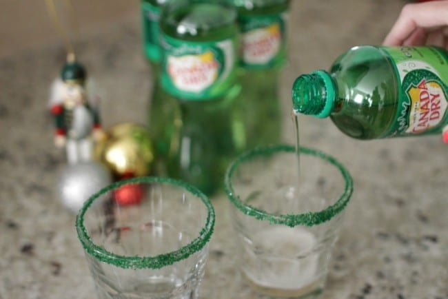 Grinch punch recipe - this punch is perfect for a Grinch viewing party. With its bright green color and deliciously sweet flavor and crunch from the sugar crystals, you can't go wrong. This might even make the Grinch smile.