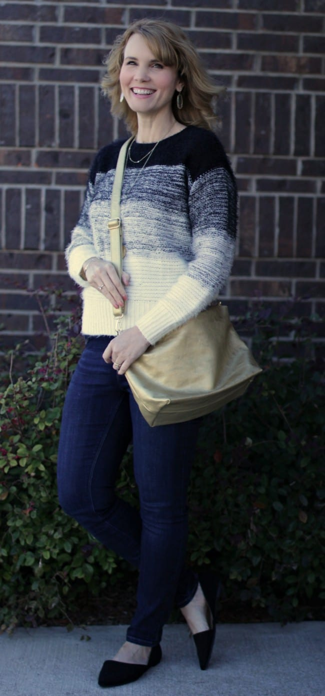 A gold purse is a nice accessory piece to add a little something extra to your outfit.