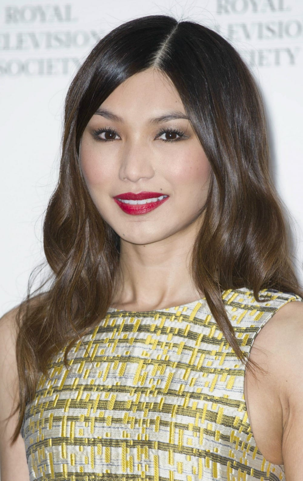 Best hair styles of the week - Gemma Chan has a slight ombre look to her hair. It starts off darker at the top and gradually gets a bit lighter towards the ends.