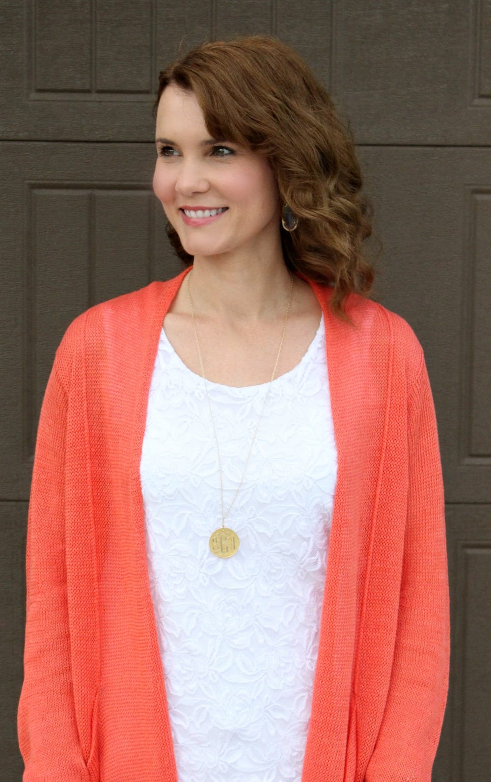 Spring outfit idea - nude patent wedges, white denim, white lace top and a coral cardigan.