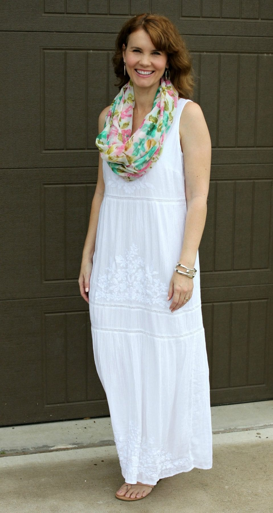 White Summer Dress - wear this to a casual summer wedding, event or strolling on the beach. The dress is lined, has a beautiful embroidered design and is so comfortable. Click through to see where you can purchase it.