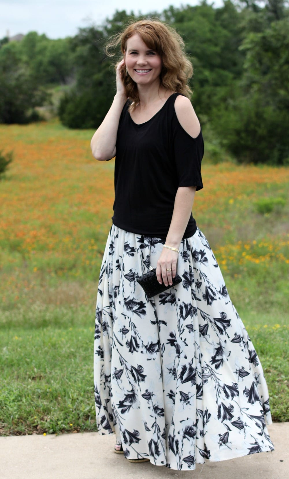 A dressed up maxi skirt outfit - break out the off the shoulder shirt or one with shoulder cutouts, pair it with a maxi skirt, wedges, clutch and some pretty accessories for the perfect date night summer outfit.