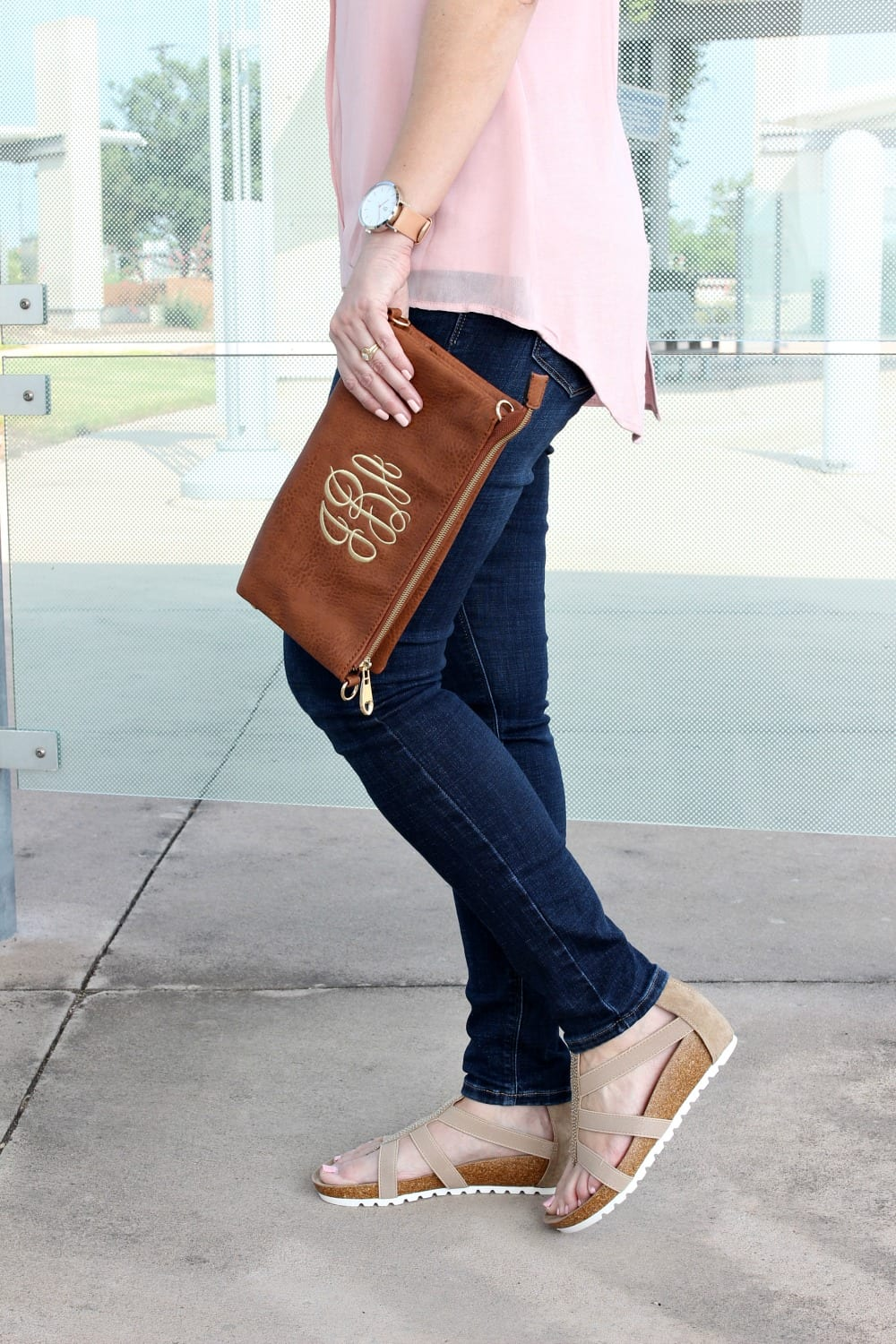 Spring Outfit Ideas - pair a pink hi-low hem tank with denim and sandals.