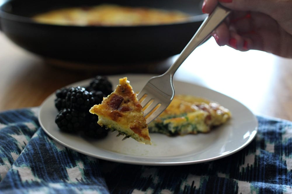 Looking for frittata recipes? This Bacon and Spinach Frittata is perfect for breakfast, lunch or dinner. With ingredients like bacon, fresh spinach and onion, it's full of flavor and a complete meal. Just add some fresh fruit and you're good to go!