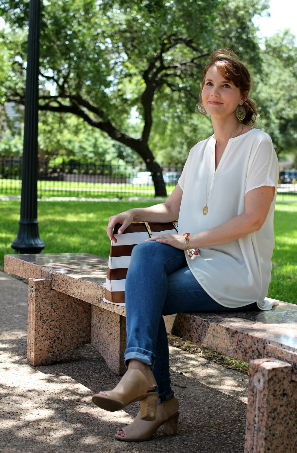 I love tunic tops and they make putting together an outfit I feel good in so easy. This classic tunic from J. Jill is paired with light denim, nude peep toe booties and a striped tote bag.