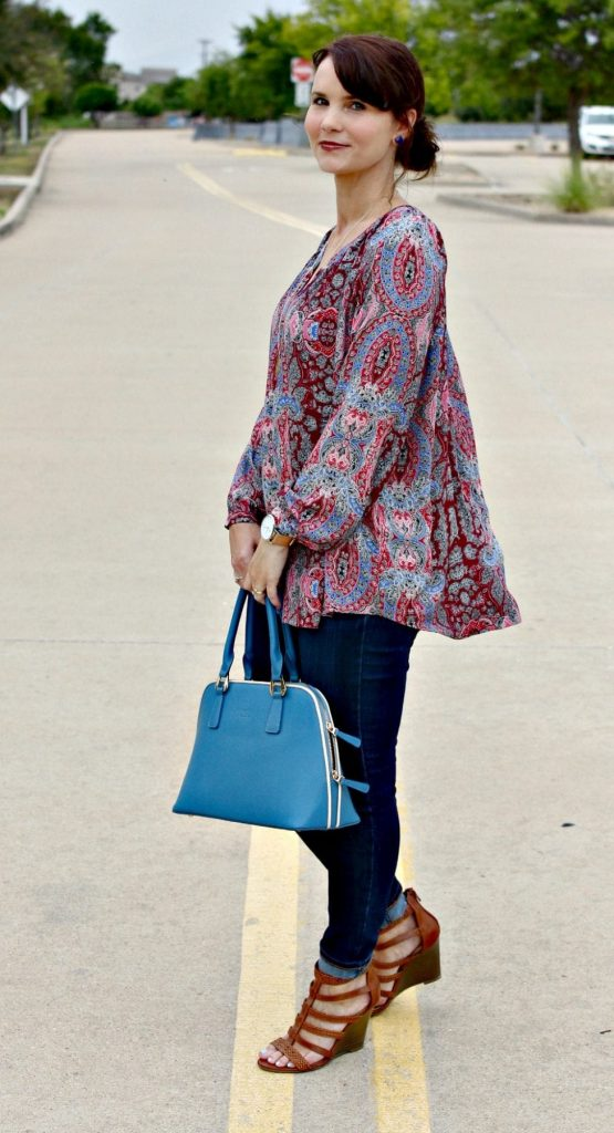 Women's Fall Outfit Ideas featuring a paisley print blouse, blue handbag and wedges.