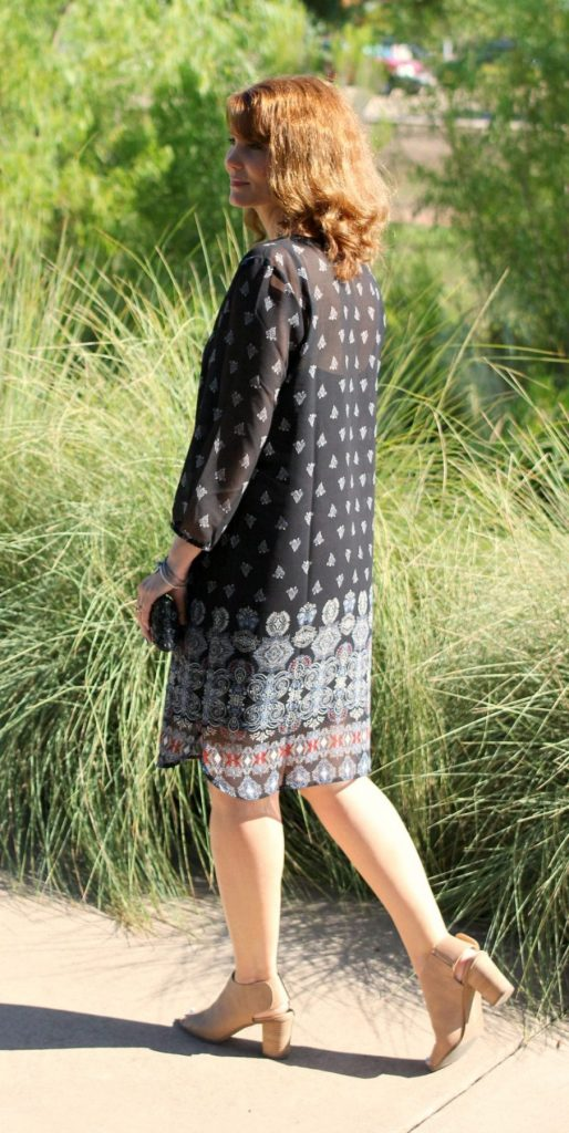 Outfit ideas for women: A pullover dress that's perfect for the summer to fall transition time. Pair it with ankle or peep toe booties and some accessories.