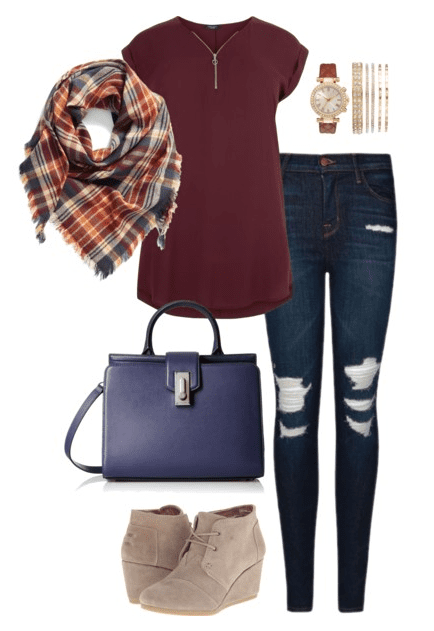 Fall outfit idea - pair a burgundy tunic with distressed denim, a scarf and blue handbag. Navy and burgundy are the perfect color combo for fall.