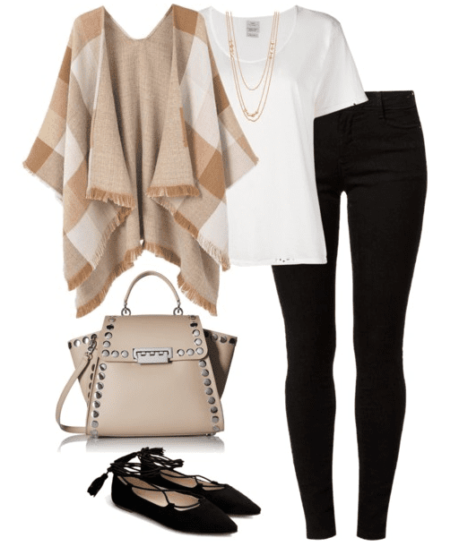 Fall outfit idea - Pair a white tee and cape, with black denim, black flats and a cream colored designer handbag.