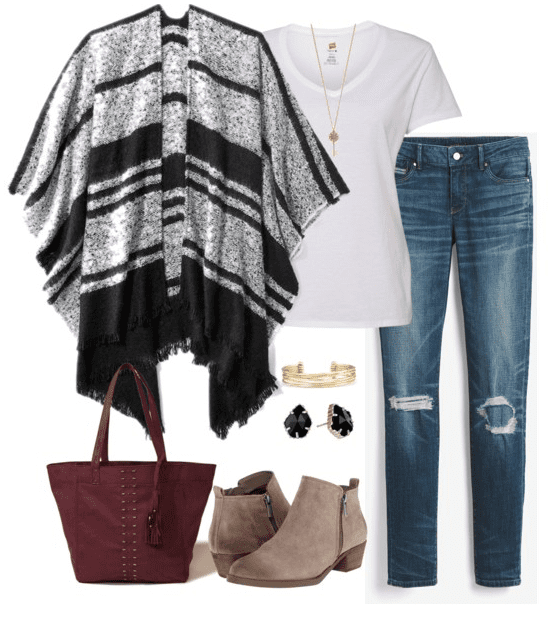 Poncho outfit idea for fall - pair a black and white poncho with a white t-shirt, distressed denim, ankle booties and a burgundy tote for a stylish fall outfit.