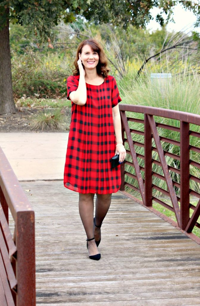 If you're looking for a Holiday dress that's modest, comfortable and covers in all the right places, the Buffalo Plaid Pleated Dress is for you.