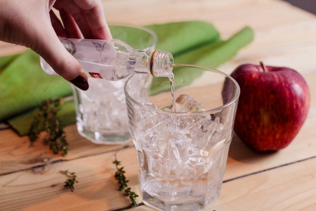 Adam's Apple Cocktail Recipe - This cocktail is super easy and very flavorful! Whether you're having a quiet night at home or want to impress friends, whip this up for a tasty drink to serve. It only requires 3 ingredients + the sprig of thyme and slice of apple which give it a great look.