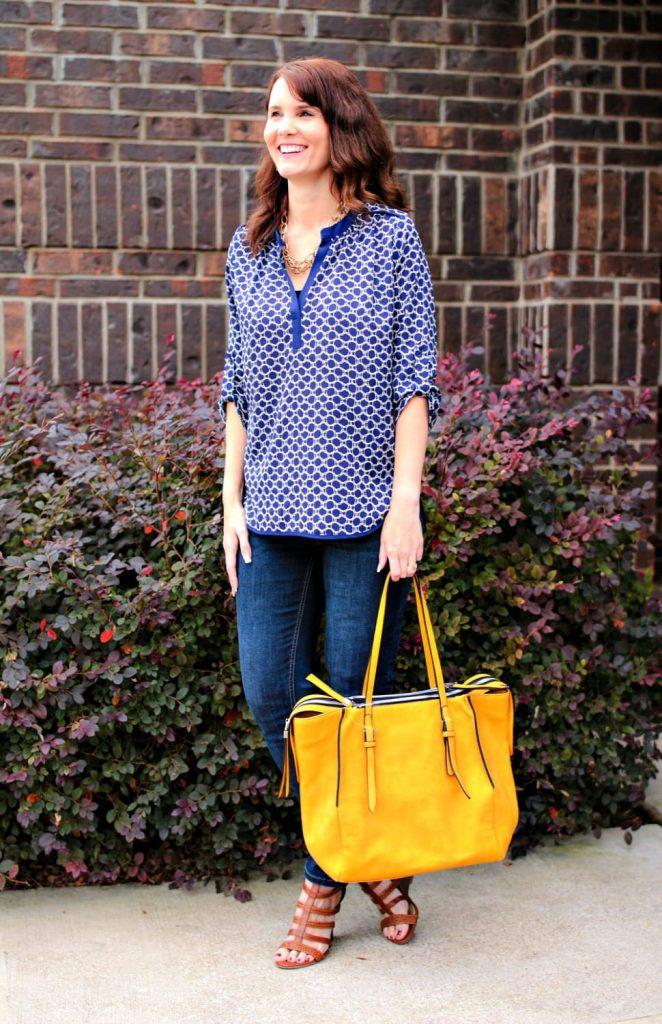 Stitch Fix outfit: Split neck navy blue blouse, dark denim, mustard tote, caged wedges.