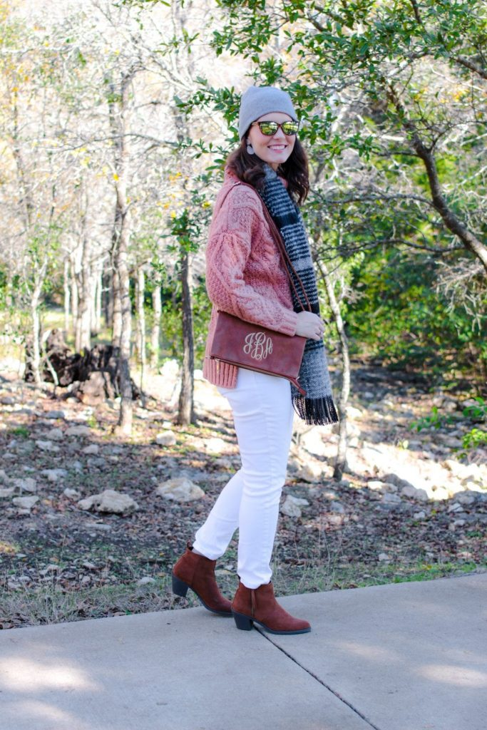 White jeans outfit winter edition: mauve sweater, white denim, brown ankle boots.