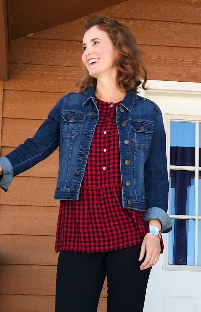 Casual outfit idea: Gingham top, denim jacket, black slacks and ankle boots.