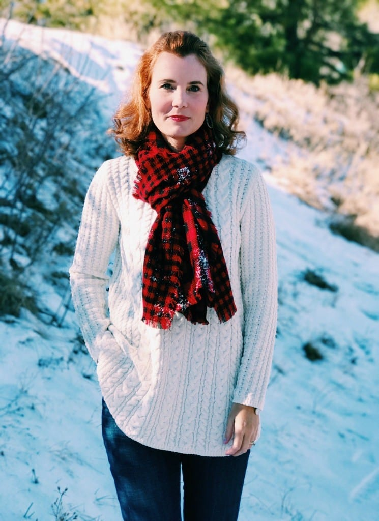 Christmas outfit idea: Ivory chenille sweater, buffalo plaid scarf, jeans and boots.