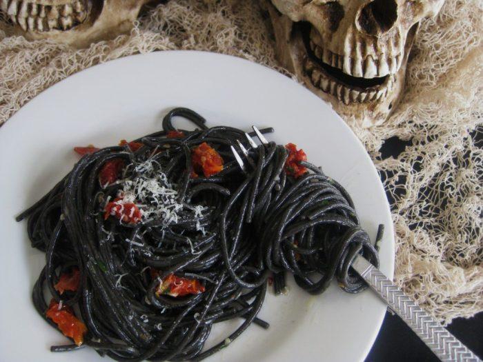 A bowl of black spaghetti for halloween dinner