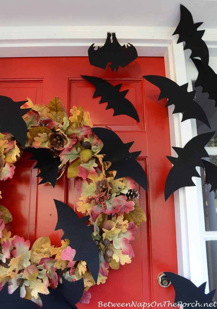 paper bats taped to a front door