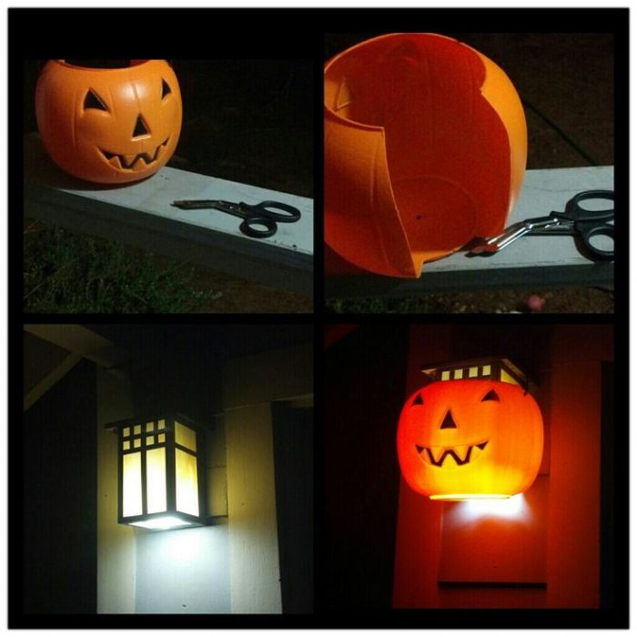 A plastic pumpkin placed over a front porch light